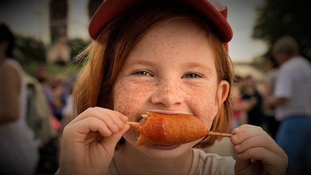Child-eats-Corny-Dog-at-State-Fair-of-Texas